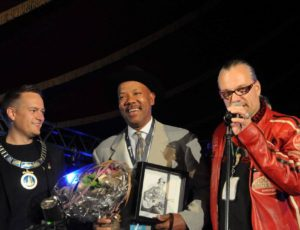 Michael receiving the Hell Blues Festival Award with the Mayor and Kjell 'Jolly Jumper' Brovoll, Norway 2015